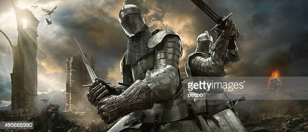 Dois Medieval Cavaleiros com Swords no campo de batalha perto de Cabana monumentos