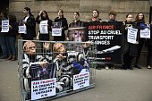 Two members of PETA in a cage demonstrate against the French airline Air France to denounce the transport of primates to laboratories as others PETA...