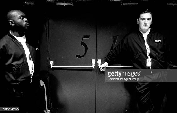 Two members of security stand by the main Fac 51 doors to the Hacienda Manchester early 1990's