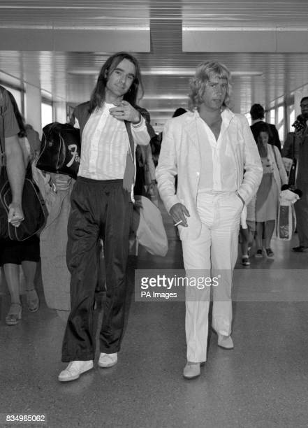 Two members of the British rock band Status Quo Francis Rossi and Rick Parfitt on arrival at London's Heathrow airport