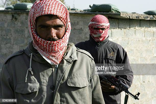 Two members of the Concerned Local Citizens stand guard at a check point south of Baghdad Members of the CLC receive monthly payments for their...