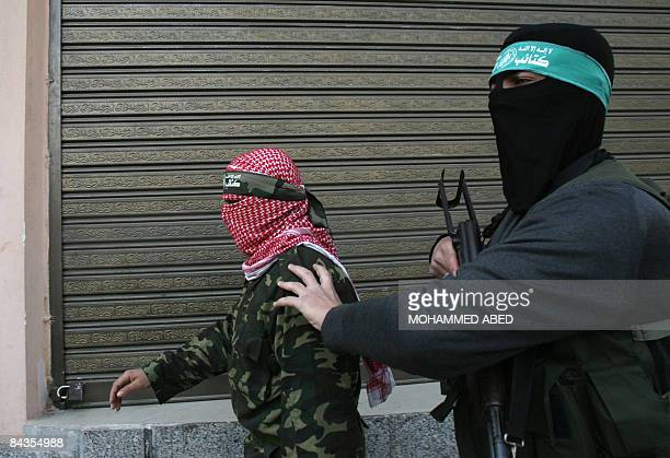 Two members of the Ezzedine AlQassam brigades Hamas's military wing leave after giving a press conference in Gaza City on January 19 2009 Hamas's...