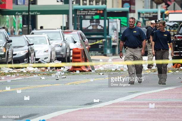 Two members of the Federal Bureau of Investigation work at the scene of Saturday night's explosion in the Chelsea neighborhood of Manhattan September...