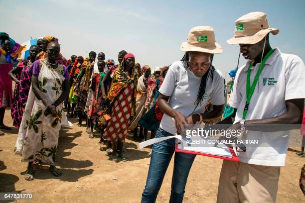 Two members of the German NGO Welthungerhilfe register the beneficiaries of a food distribution on March 4 in a stabilisation center in Ganyiel...
