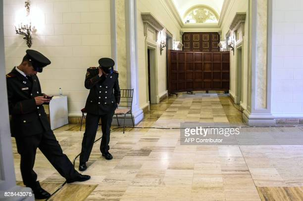 Two members of the National Guard keep watch at the entrance to the protocol hall where the sessions of the constituent assembly take place at the...