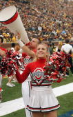 Two members of the Ohio State Buckeyes cheerleading team pump up the crowd during the game against the Michigan Wolverines in the 100th meeting of...