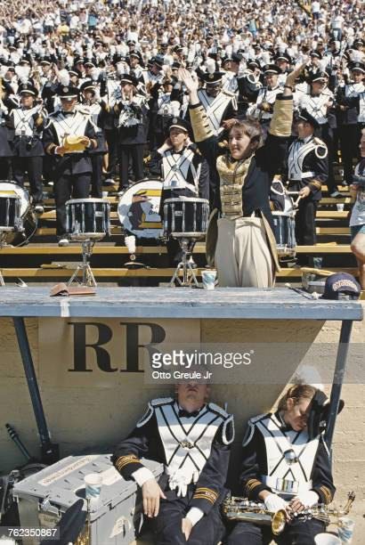 Two members of the University of California Berkeley marching band sleep as the rest of the band and spectators cheer on the California Golden Bears...