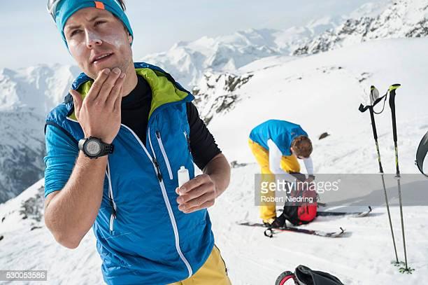 Two men Alps mountains ski tour winter