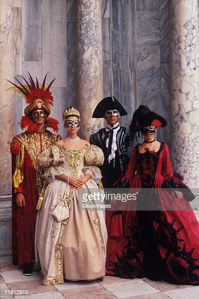 Two men and two women wearing costumes, Venice, Veneto, Italy