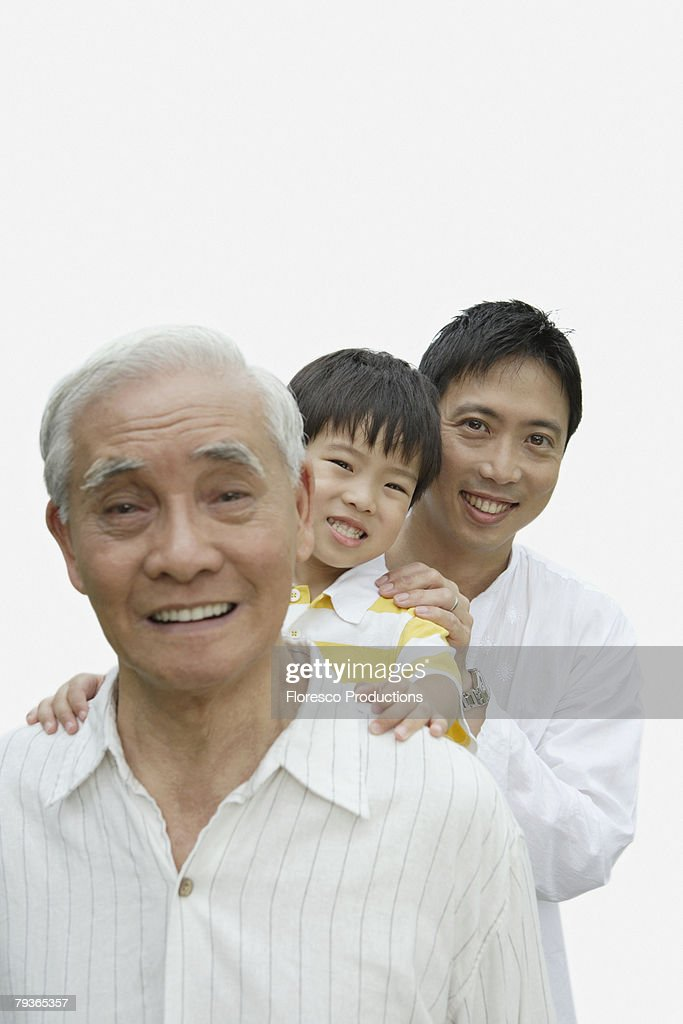 Two men and young boy indoors bonding : Stock Photo