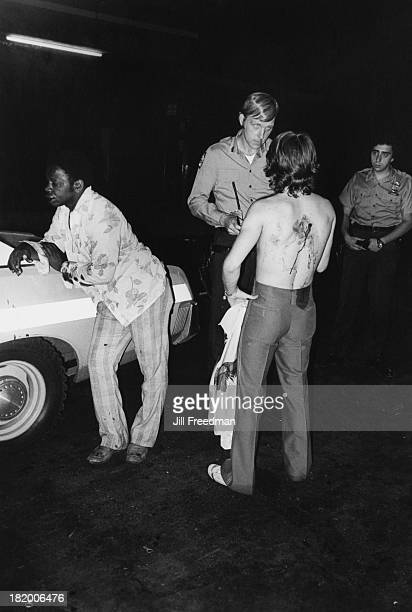 Two men are arrested after being caught fighting in the street New York City 1978