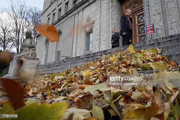 Two men are seen 15 November 2007 at the entrance of the World Trade Organization headquarters in Geneva AFP PHOTO / FABRICE COFFRINI