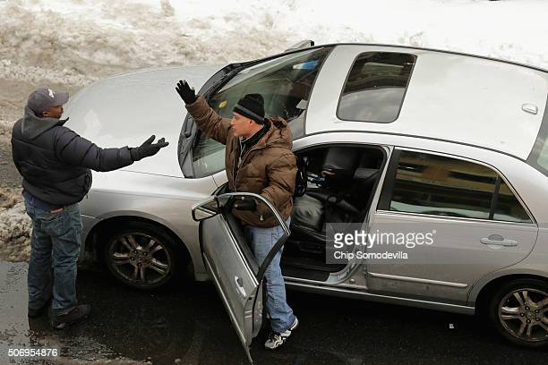 Two men argue after their cars came headtohead on a street narrowed by snowfall in the Columbia Heights neighborhood following the weekend blizzard...
