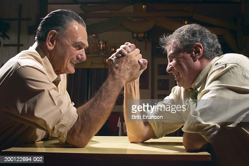 Two men arm wrestling, close-up