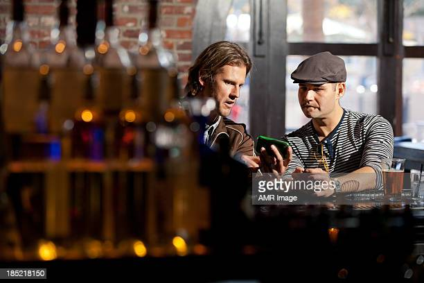 Two men at a bar