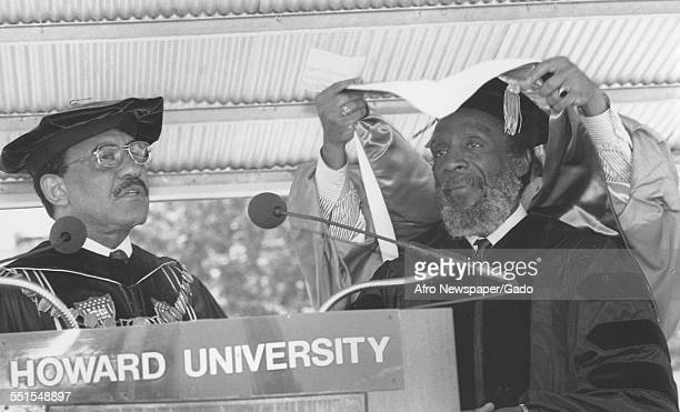 Two men at Harvard University at an event in full regalia academic dress Dr James Church and author and satirist Dick Gregory Boston Massachusetts...
