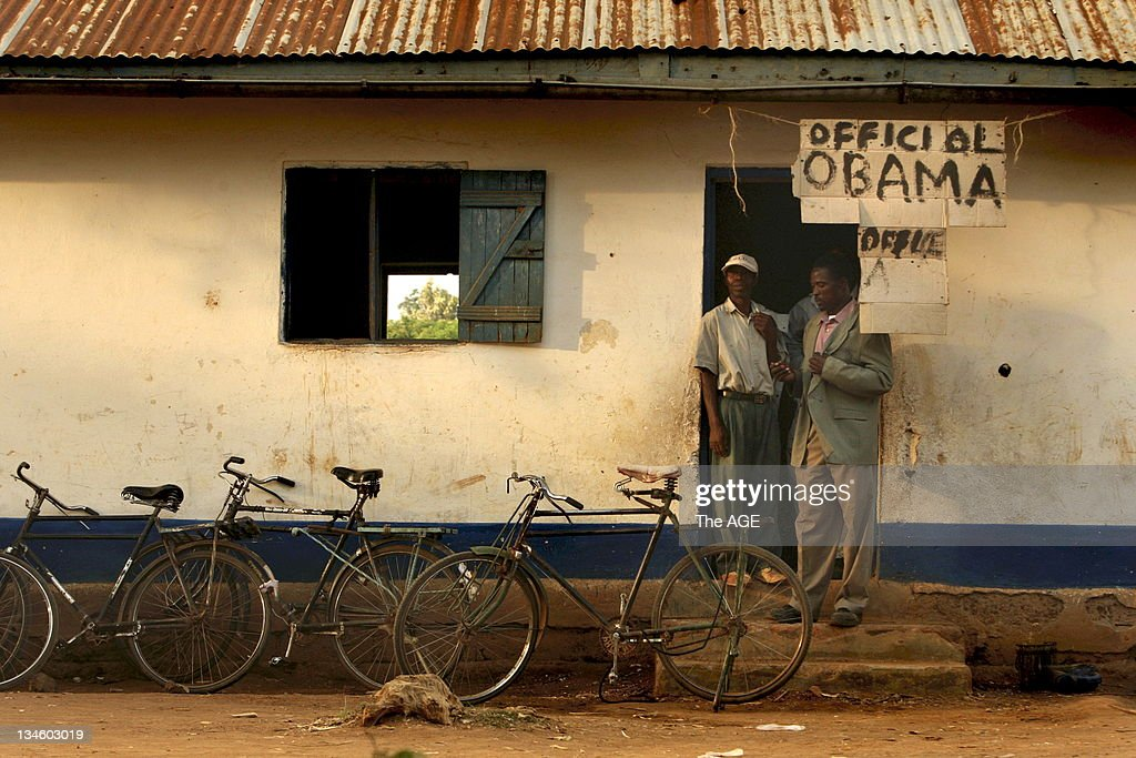 Two men at the official Obama office at the Senator Obama primary school in Kogelo, Kenya, before watching the inauguration of Barack Obama live as he is sworn in as the 44th President of The United States of America. Kogelo is the Kenyan village where his father Barak Obama Senior was born and the Presidents grandmother lives. Kogelo, Kenya. Today 20th January, 2009.