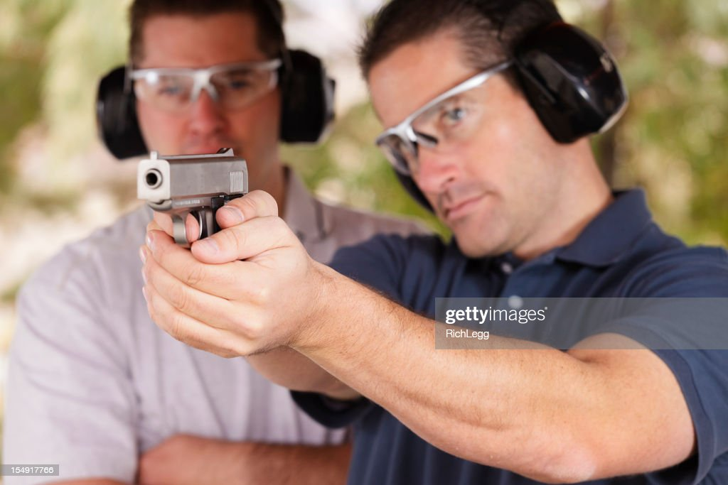 Two Men at the Shooting Range : Stock Photo