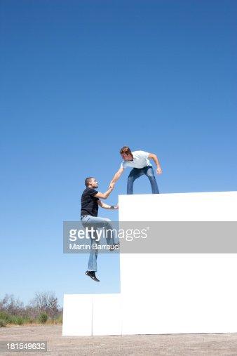 Two men atop blocks outdoors : Stock Photo