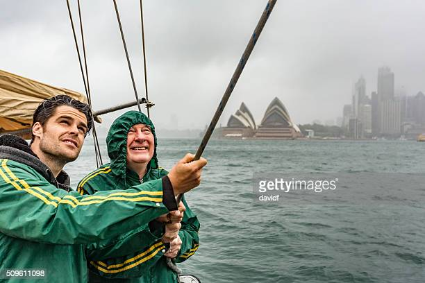 Two Men Battling a Storm on a Yacht in Sydney
