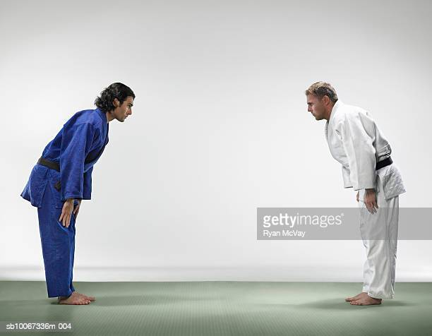 Two men bowing before judo match