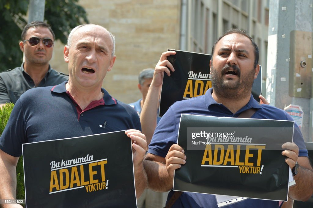 Two men chant slogans as anti-government demonstrators gathered in front of the Supreme Election Council (YSK) to protest against unsealed ballot papers in the voting for the Turkish constitutional referendum in Ankara, Turkey on August 16, 2017. The referendum was held on April 16 as the demonstrators chant the slogan 'We still search for justice' in the fourth month after historic voting.