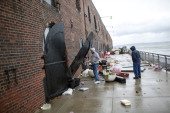 Two men check on damage to artist's studios and warehouses on October 30 2012 in the Red Hook neighborhood of the Brooklyn borough of New York City...