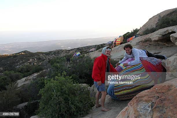 Two men check out a yarn bomb at Lizard's Mouth Santa Barbara California
