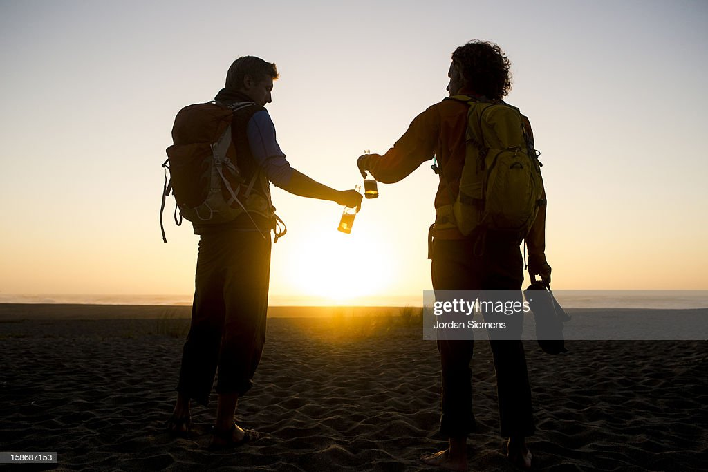 Two men cheers with their beers. : Stock Photo