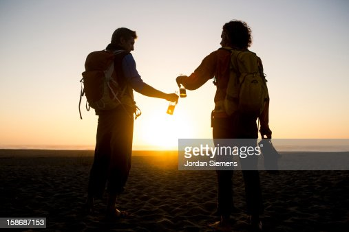 Two men cheers with their beers. : Foto de stock