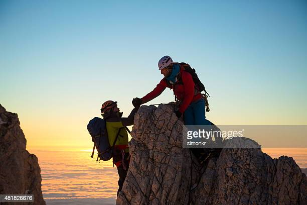Two men climbing on rock