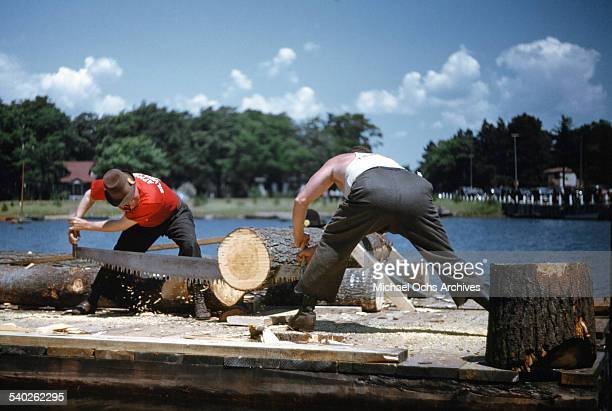 Two men compete in a log sawing competition during a Lumberjack/Logging festival in Northern Michigan