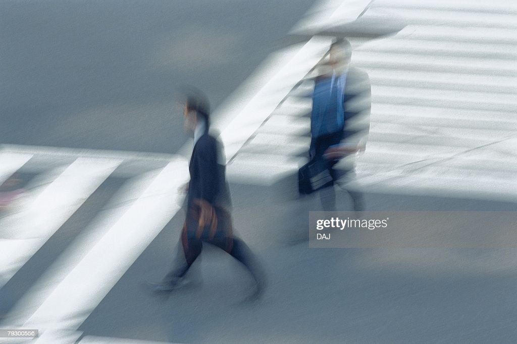 Two men crossing at the crosswalk, high angle view, blurred motion, Tokyo, Japan : Stock Photo