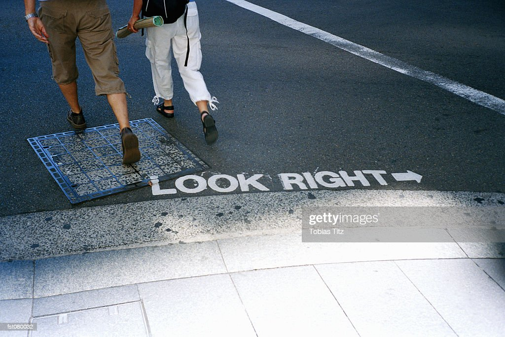 Two men crossing the street, Australia