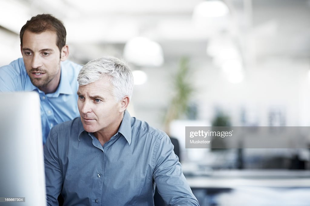 Two men discussing a project : Stock Photo