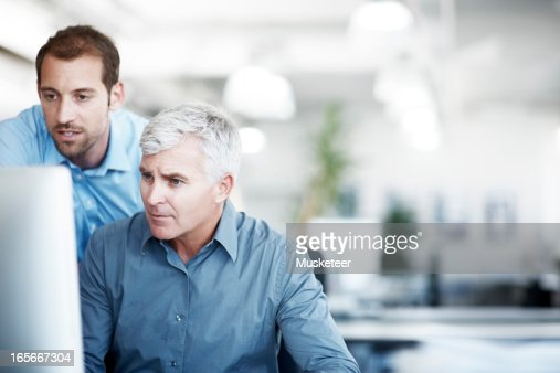 Two men discussing a project