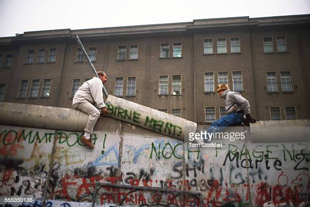 Two men dismantle part of the Berlin Wall near Checkpoint Charlie on November 10 the day the Wall fell