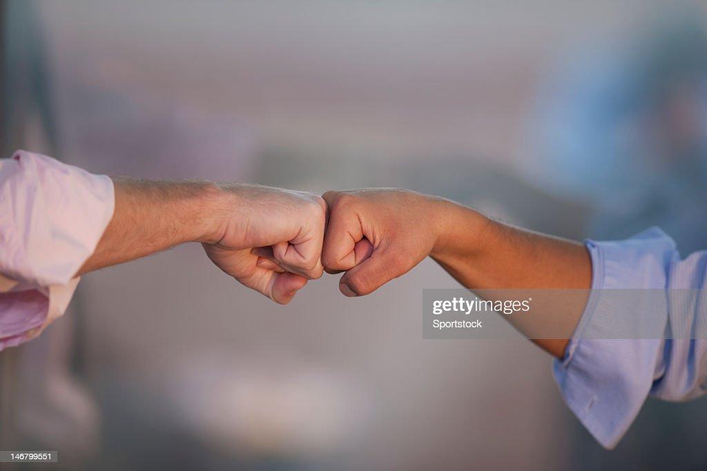 Two Men Doing Fist Bump (Modern Handshake)