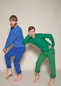 Two men dressed in blue and green posing