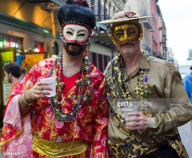 Two men dressed in costume in the French Quarter during the 2011 Mardi Gras Fat Tuesday Celebrations on March 8 2011 in New Orleans Louisiana
