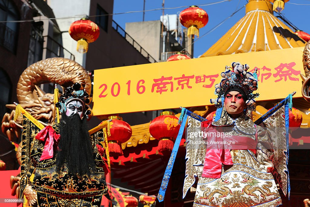Two men dressed in traditional Chinese costumes perform in celebration of the Chinese New Year a stage at the Nankinmachi square, China Town on February 8, 2016 in Kobe, Japan. In Nankinmachi, the district known as Kobe Chinatown, tourists enjoyed Chinese food, lion dance and the parade organized to celebrate the Lunar New Year.