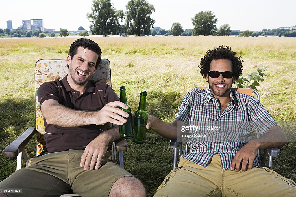 Two men drinking beer : Stock Photo
