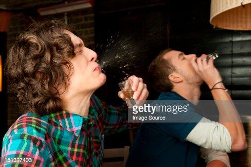 Two men drinking shots