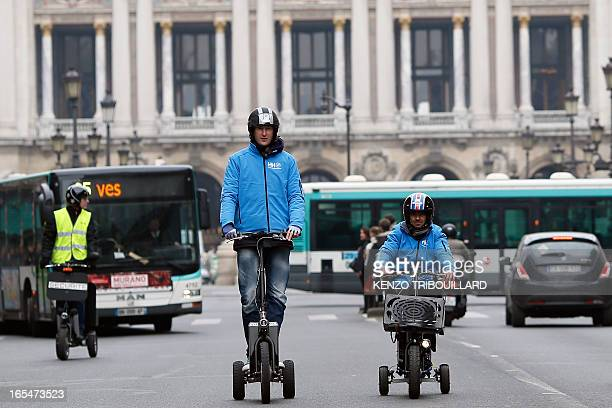Two men drive hydrogen powered tricycles on April 4 2013 in Paris AFP/PHOTO KENZO TRIBOUILLARD