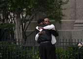 Two men embrace outside the funeral of Philando Castile at the Cathedral of St Paul on July 14 2016 in St Paul Minnesota Castile was shot and killed...