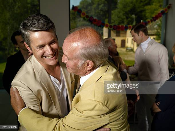 Two men embracing at family party