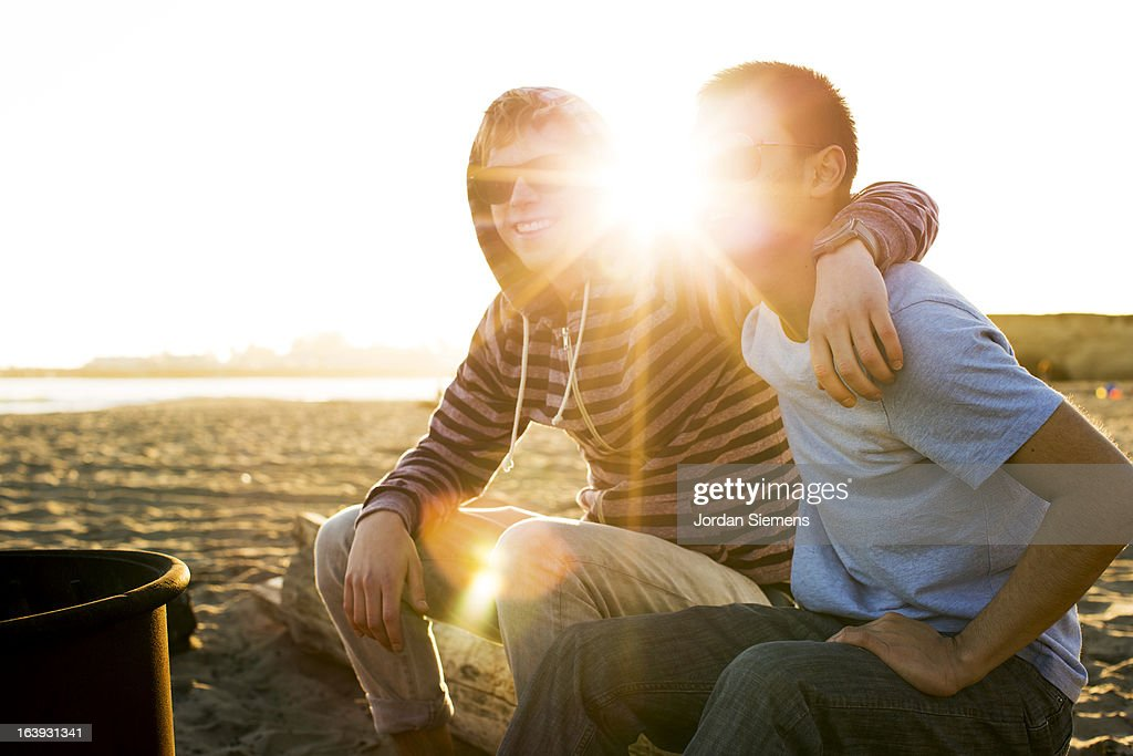 Two men enjoying a day at the beach. : Stock Photo
