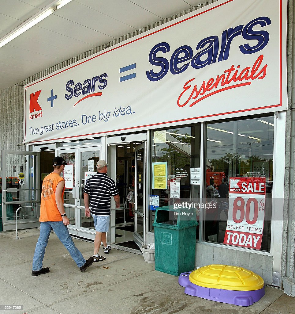 Two men enter a current Kmart store May 18, 2005 in Palatine, Illinois. This particular Kmart is in transition to become one of Sears' new stores called 'Sears Essentials.' Kmart recently bought Sears, Roebuck and Co. for $12.3 billion.