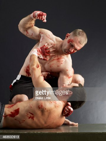 Two men fighting and bloody : Stock Photo