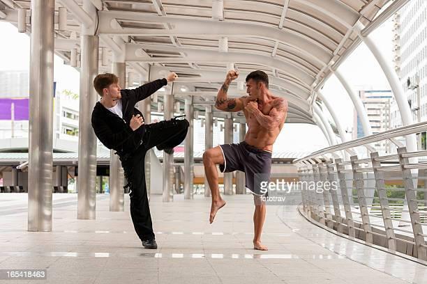 Two men fighting in urban environment